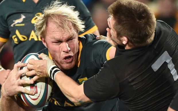 Schalk Burger of the Springboks tries to hand off Richie McCaw of the All Blacks.