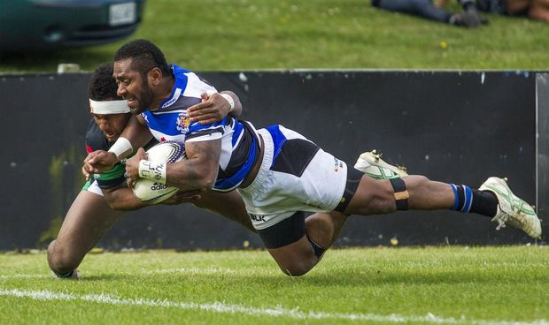 Michael Nabuliwaqe of Wanganui scores a try in the tackle of South Canterbury's Rupeni Cokanasiga during the Meads Cup final, South Canterbury v Wanganui held at Alpine Energy Stadium, Timaru. 24 October 2015 Photo: Joseph Johnson / www.photosport.nz
