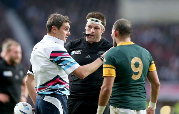 French referee Jerome Garces with Richie McCaw and Fourie du Preez RWC2015