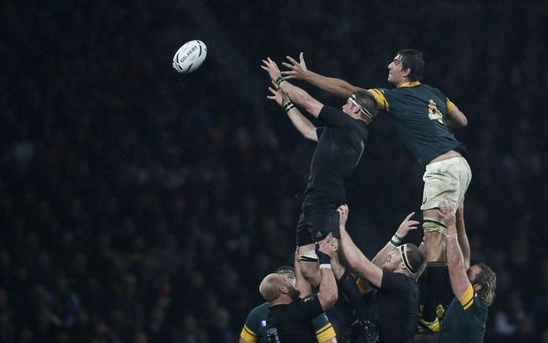 Richie McCaw snatches the lineout ball from South African lock Eben Etzebeth.