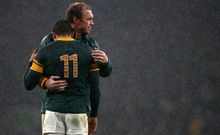 South Africa's Schalk Burger consoles team mate Bryan Habana at the final whistle.