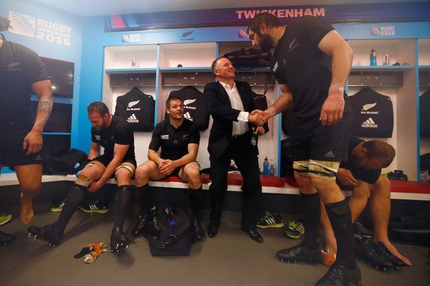 John Key congratulating Sam Whitelock.