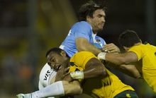 Marcelo Bosch is tackled by Australia's Tevita Kuridrani.