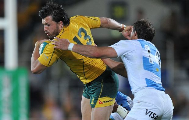 Adam Ashley Cooper of Australia is tackled by Pumas.