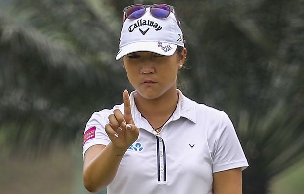 Lydia Ko lines up a putt in Malaysia, 2015.