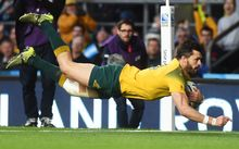 Wallabies winger Adam Ashley-Cooper scores a try.