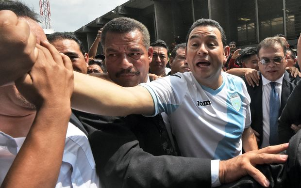 Guatemalan presidential candidate Jimmy Morales greets supporters before voting in Mixco, near Guatemala City.