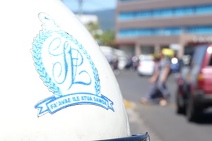 The Samoa Police crest on a patrol bike in downtown Apia.