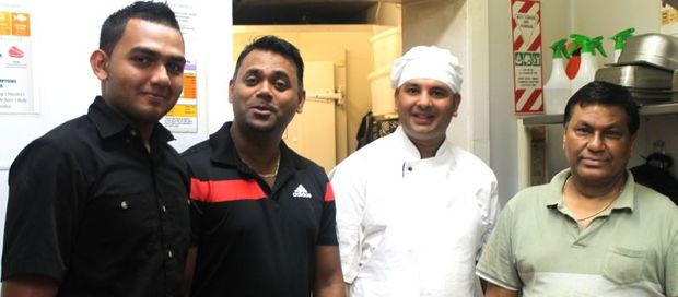 This is an image  of Rajesh Kumar (second from left)  and his kitchen team