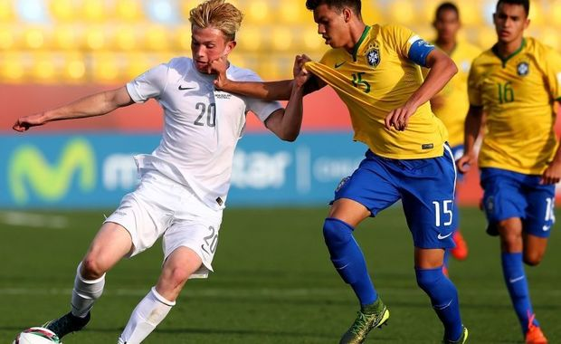 New Zealand striker Lucas Imrie battles for possession against Brazil at the under 17 World Cup.
