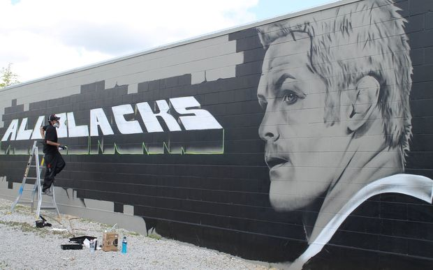 Street artist Tane Lawless has painted a giant mural of a serious looking Richie McCaw in Taupo.