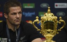 Richie McCaw with the Webb Ellis Cup into a post match press conference following the final of the 2015 Rugby World Cup between New Zealand and Australia at Twickenham.