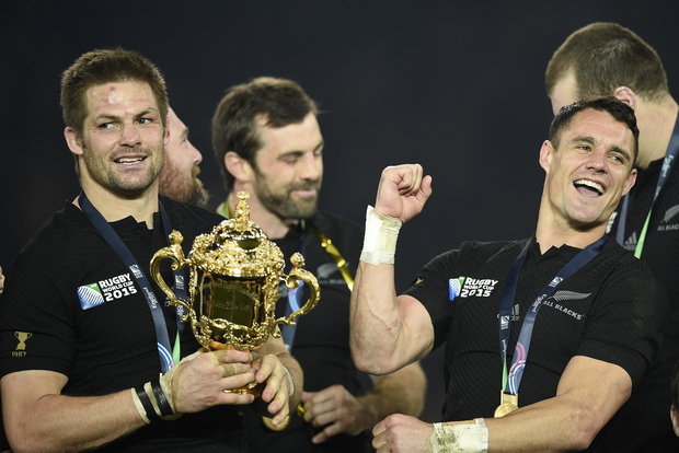 New Zealand's flanker and captain Richie McCaw (L) holds the Webb Ellis Cup next to New Zealand's fly half Dan Carter as they celebrate with teammates after winning the final match of the 2015 Rugby World Cup