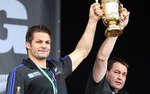All Black captain Richie McCaw and coach Steve Hansen hold the world cup high during the official Auckland celebrations.