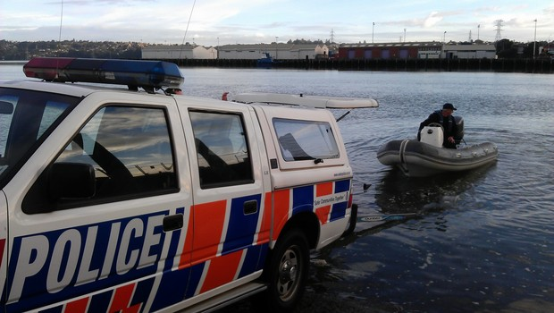The Police Maritime Unit enters the water at Mangere bridge.