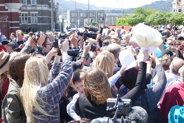 Crowds strain for a glimpse of the royal couple in Dunedin.