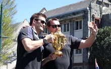 All Blacks captail Richie McCaw, left, and coach Steve Hansen during a victory parade in Christchurch.