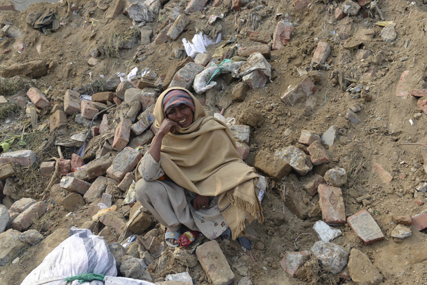 Pakistani woman Nasreen Bibi waits for news of her son missing under the rubble.