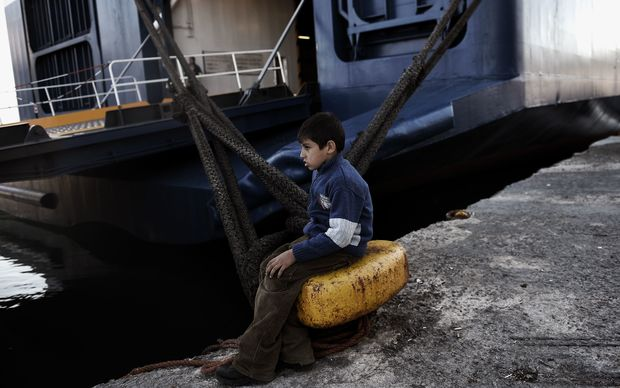 A boy waits at the port of Lesbos Island due to a strike of Greece's seamen's federation on November 4, 2015 in Mytilene.
