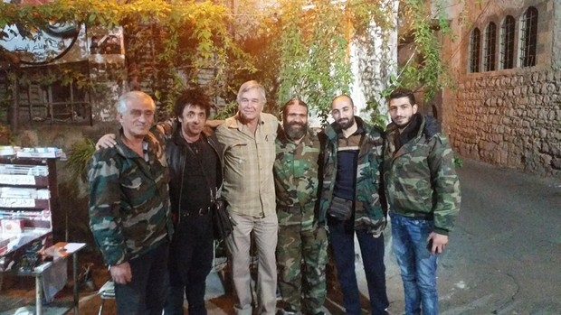 Warren Marriner poses with Syrian National Defence Force troops in Damascus.