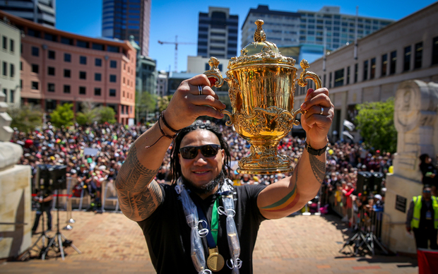 All Blacks Ma'a Nonu, lifting the Webb Ellis Cup in front of his home crowd.