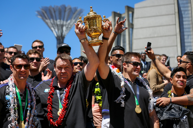 The All Blacks lift the Webb Ellis Cup in Wellington.