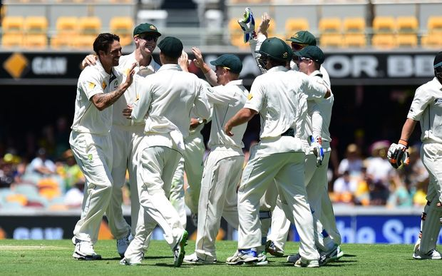 Mitchell Johnson and the Australian team celebrate the wicket of BJ Watling on day 3, 7 November 2015. New Zealand tour of Australia, 1st test at Brisbane 5-9 November 2015. Copyright photo: www.photosport.nz
