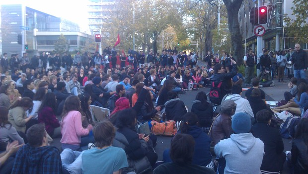Students blocked an intersection on Symonds Street in Auckland.