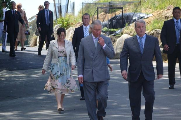 Prince Charles is escorted around the Mahana Winery by owner Glenn Schaeffer (right).