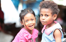 Indonesian and West Papuan girls play in a market in Jayapura.