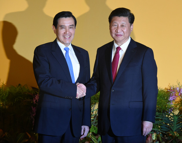 Chinese President Xi Jinping (right shakes hands with Taiwan President Ma Ying-jeou before their meeting