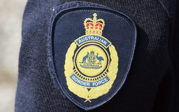 Australian Border Force logo on the uniform of an officer in Brisbane