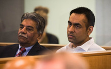 Gurjinder Singh (right) sitting in the dock at Auckland High Court with a translator (left).