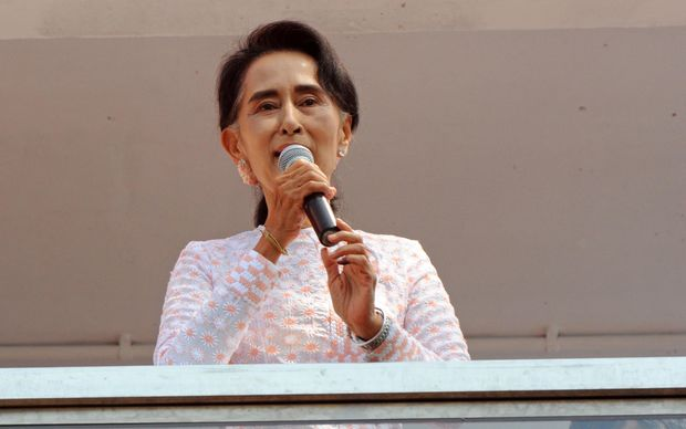 Aung San Suu Kyi, at NLD headquarters in Yangon, urged followers to be patient.