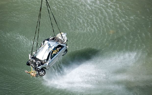 A Royal New Zealand Air Force NH90 helicopter works with a police dive team to recover a car from the Mohaka River.