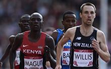 (L-R) Kenya's James Kiplagat Magut and New Zealand's Nick Willis compete in the heats the men's 1500m athletics event at Hampden Park during the 2014 Commonwealth Games in Glasgow, Scotland on August 1, 2014.