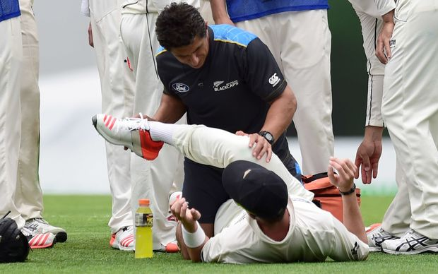 Tim Southee gets treatment from the Black Caps physio during the first test at the Gabba in Brisbane.