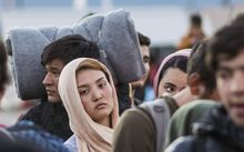 Migrants and refugees wait for a train heading to Serbia from the Greek-Macedonian border