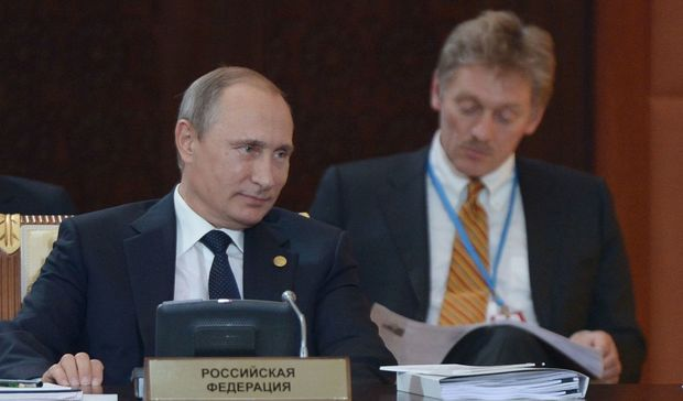 Russian President Vladimir Putin and press secretary Dmitry Peskov attend an expanded format meeting of the Supreme Eurasian Economic Council. Aleksey Nikolskyi/RIA Novosti