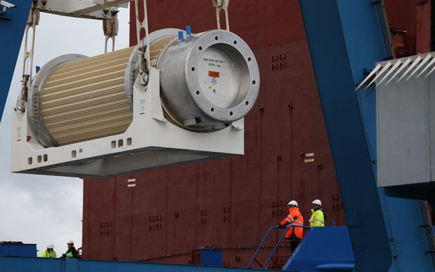A transport storage cask for the return of high activity waste from reprocessing is loaded onto the BBC Shanghai cargo ship in Cherbourg-Octeville. The vessel is to deliver nuclear waste back to Australia after its reprocessing in France. AFP PHOTO / CHARLY TRIBALLEAU
