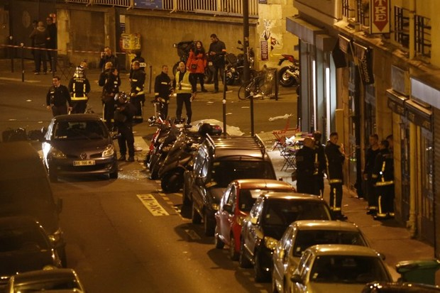 Rescuers and police cordon off the area close to Rue Bichat following several attacks in Paris