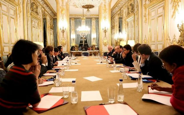 French president Francois Hollande (5-R) addresses an emergency meeting at the Elysee Palace early on November 14, 2015.