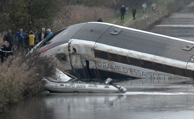 The high-speed TGV train lies partly submerged in a canal near Strasbourg, northeastern France.