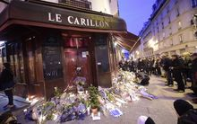 Tributes left at the Le Carillon bar and neighbouring  Le Petite Cambodge restaurant, site of one of the attacks.