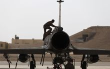A French army technician inspecting a Mirage 2000 fighter jet at a base in Jordan, 12 October 2015.