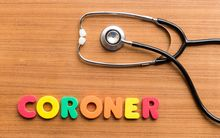 Stethoscope and the word coroner