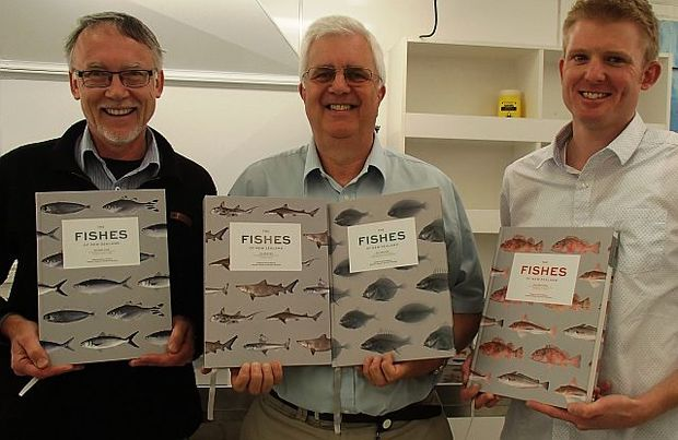 Andrew Stewart, Clive Roberts and Carl Struthers, editors of The Fishes of New Zealand, holding up the four volumes of the book