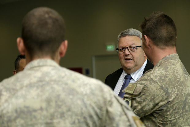 Troops returning from Iraq are welcomed by Defence Minister Gerry Brownlee at Ohakea Air Base on 16 November 2015.