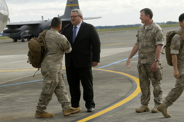 Troops returning from Iraq are welcomed by Defence Minister Gerry Brownlee and Commander Joint Forces New Zealand Major-General Tim Gall at the Ohakea Air Base on 16 November 2015.