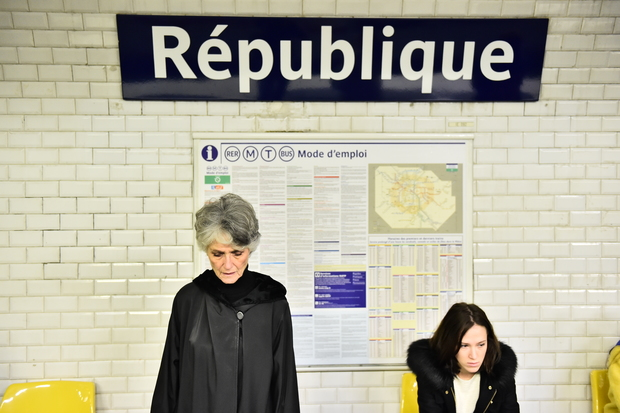 Metro passengers observe a minute of silence, on November 16, 2015 at Republique subway station in Paris, to pay tribute to victims of the attacks claimed by Islamic State which killed at least 129 people.